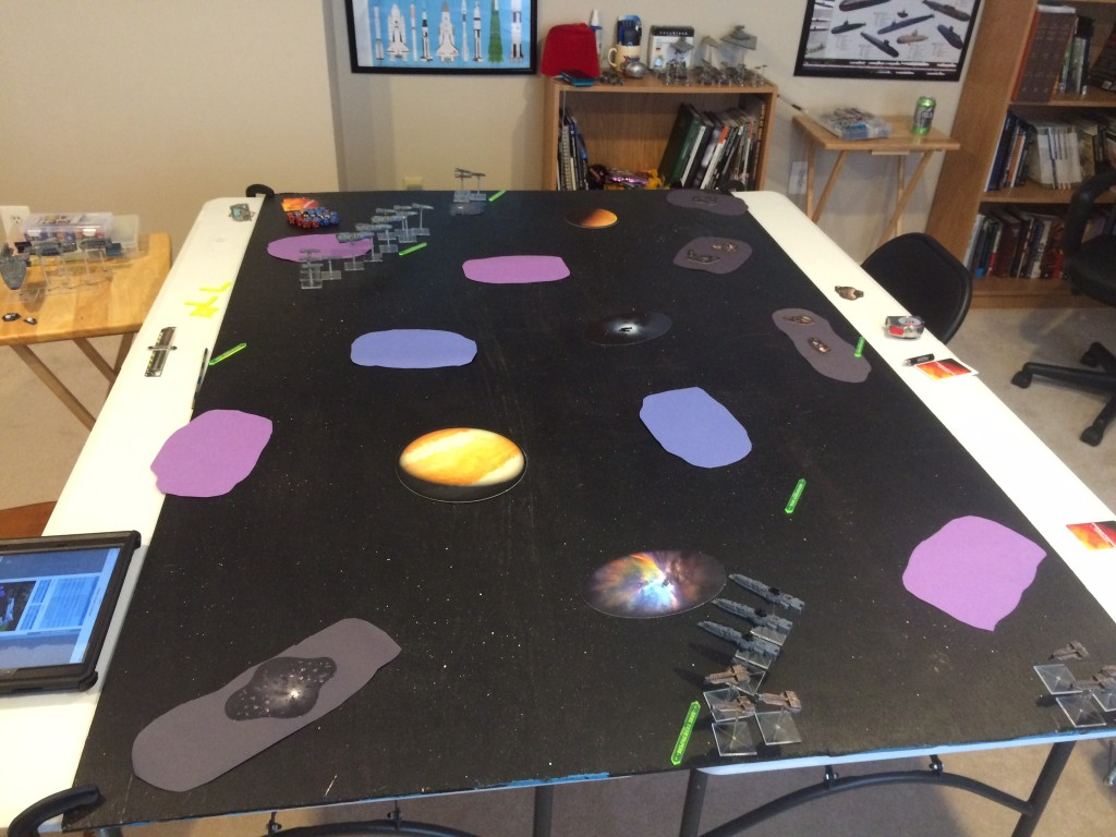 Here is the table after deployment. We are using construction paper as hastily made stand-ins for area terrain. Purple=Gas Clouds, Blue=Debris Fields, and Grey=Asteroid Fields.